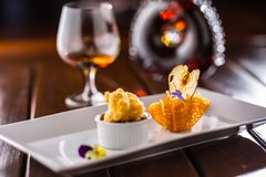 Sweet cake with peas ice cream in caramel basket. Culinary food. Sweet dessert cognac or brandy in hotel pub or restaurant Stock Photography