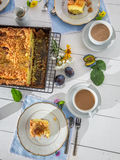 Sweet cake with plum served with coffee in the countryside Royalty Free Stock Photo