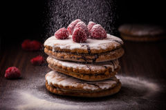 Sweet cake with raspberries on dark background. Sweet cake with raspberries on dark background Royalty Free Stock Images