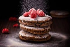 Sweet cake with raspberries on rustik background. Sweet cake with raspberries on dark background Stock Photo