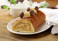Sweet cake roll with coffee cream Royalty Free Stock Photos