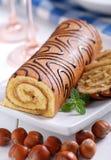 Sweet cake roll. With hazelnuts cream Stock Image