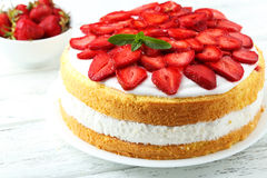 Sweet cake with strawberries Stock Image