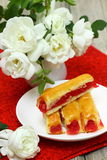 Sweet cake with strawberry. Dessert - sweet cake with strawberry on a plate with red background Shallow DOF stock photography