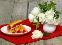Sweet cake with strawberry. Dessert - sweet cake with strawberry on a plate with red background royalty free stock images