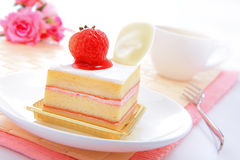 Sweet cake with strawberry at tea time Royalty Free Stock Image
