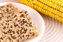 Sweet cake on white plate and corn Stock Photo