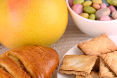 Sweet cake on white plate and fruits Stock Photos