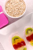 Sweet cake on white plate and fruits Stock Photography