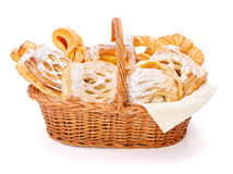Sweet cakes in basket royalty free stock photography