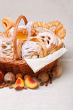 Sweet cakes in basket, fruit decoration royalty free stock photography