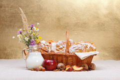 Sweet cakes in basket, fruit and milk decoration. Lots of sweet cakes in basket, fruit and milk decoration around, rustic background Royalty Free Stock Photo