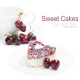 Sweet cakes with cherries on white Royalty Free Stock Photography