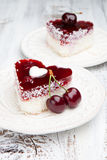 Sweet cakes with cherries on white wooden table Royalty Free Stock Photos