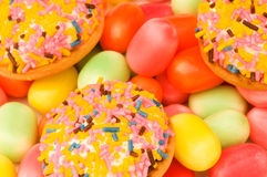 Sweet cakes and colourful gums Stock Images