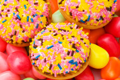 Sweet cakes and colourful gums Royalty Free Stock Photos