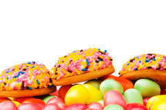 Sweet cakes and colourful gums Stock Photos
