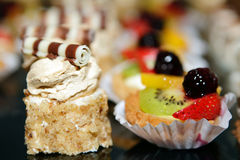 Sweet Cakes with fruits. On the Table Stock Photo