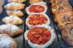 Cakes at a bakery. Sweet cakes with fruits at a bakery market Stock Photography