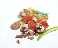 Sweet Candied Fruit And Nuts. On the white background Stock Images