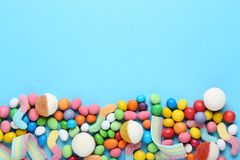 Sweet candies. On blue background royalty free stock photo