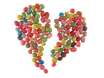Sweet candies broken heart. Sweet sugar candies broken heart bright colored on a white background. Sea stones Royalty Free Stock Image