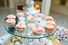 Sweet candies and cupcakes Stock Image