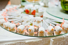 Sweet candies and cupcakes Stock Images