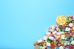 Candies and lollipop. Sweet candies and lollipop on blue background royalty free stock photos