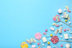 Sweet candies and lollipops. On blue background stock photos