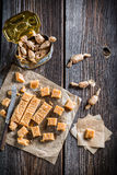 Sweet candies with sesame on baking paper Royalty Free Stock Image