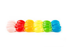 Sweet candies on white Stock Photos