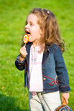 Sweet candy. Closeup portrait of little girl with lollipop Royalty Free Stock Photography