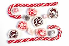 Sweet candy background. Red and maroon candies on white background. Top view stock photography