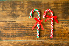 Sweet Candy Canes with red ribbon Royalty Free Stock Photography