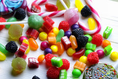 Sweet candy jelly bean on a wooden background Royalty Free Stock Photography