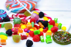 Sweet candy jelly bean on a wooden background Royalty Free Stock Images