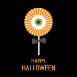 Sweet candy lollipop with green eyeball. Black bow. Happy Halloween card. Flat design Royalty Free Stock Photos