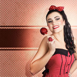 Sweet candy pinup girl with vintage toffee apple Royalty Free Stock Photos