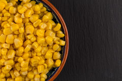 Sweet canned corn in bowl Stock Images