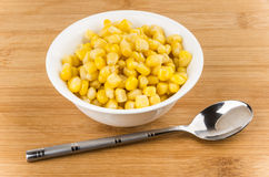Sweet canned corn in small bowl ant spoon Royalty Free Stock Images