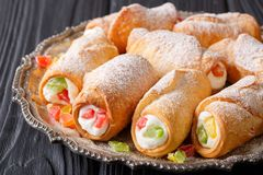 Sweet cannoli stuffed with cheese cream and candied fruits close Royalty Free Stock Photography