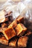 Sweet caramel candies.  Salted caramel pieces and sea salt close Royalty Free Stock Photos