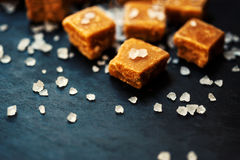 Sweet caramel candies. Salted caramel pieces and sea salt close Stock Photo