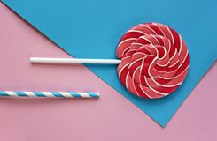 Sweet caramel candy on a stick on a bright background. Composition. Sweet caramel candy on a stick on a bright background. Top view beauty. Composition Stock Images