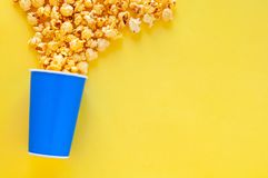 Sweet Caramel Popcorn in blue paper bucket stock image