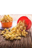 Sweet caramel popcorn in a bowl on blue cotton napkin against wo Royalty Free Stock Images