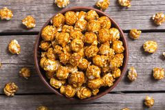 Sweet caramel popcorn. Food and snack background in bowl royalty free stock image