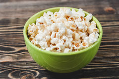 Sweet Caramel Popcorn in Green Bowl on Wooden Background Royalty Free Stock Photography