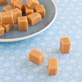 Sweet caramel toffees on a plate Royalty Free Stock Photo